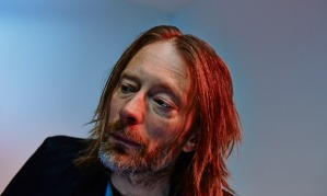 Thom Yorke sings Ireland's Call by controlling a series of robots through blinking movements.